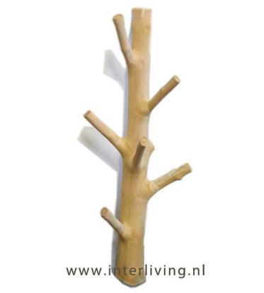 kale houten stam  - kapstok aan de muur met takken