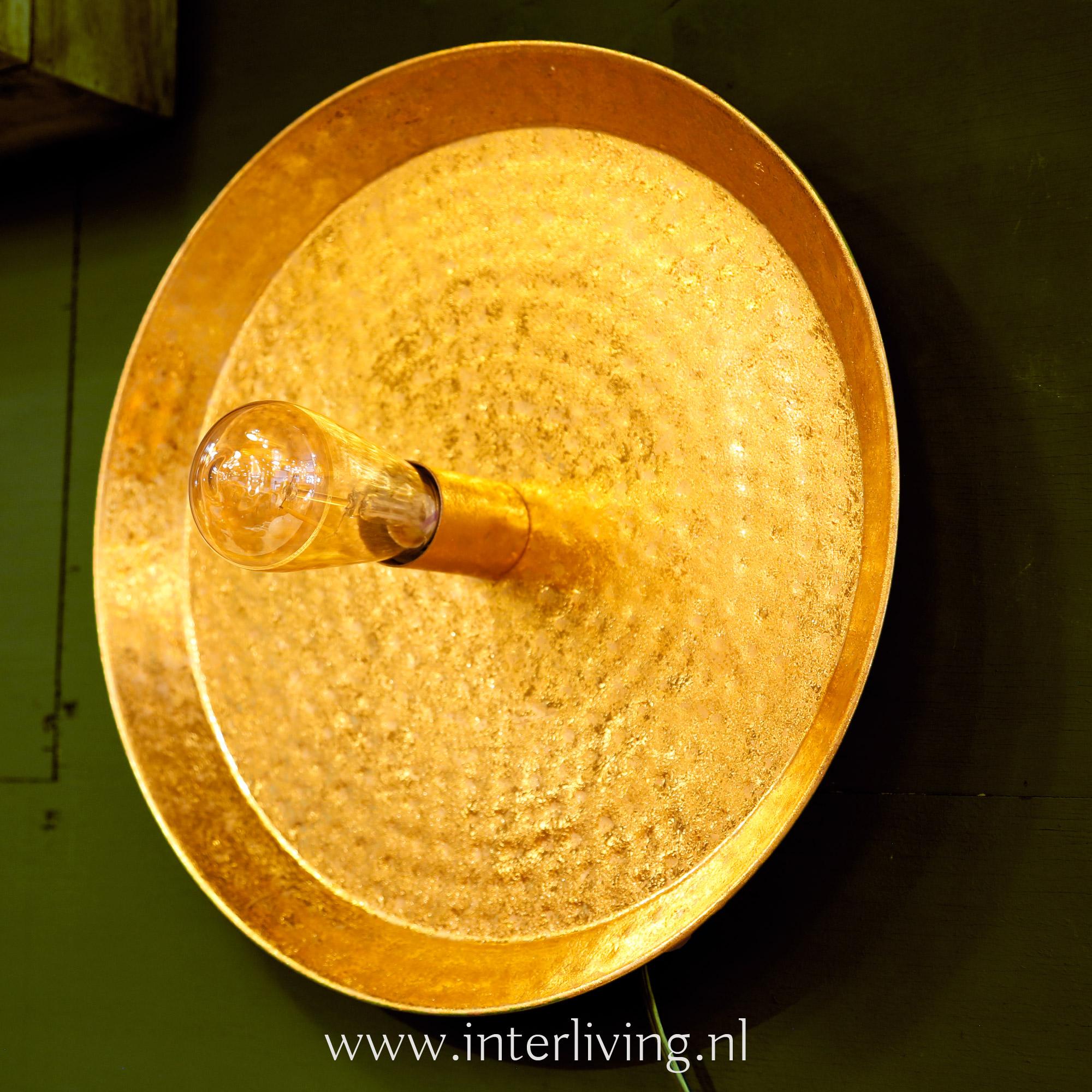 goudkleurige ronde wandlamp voor aan de muur - hotel chic interieur stijl metalic